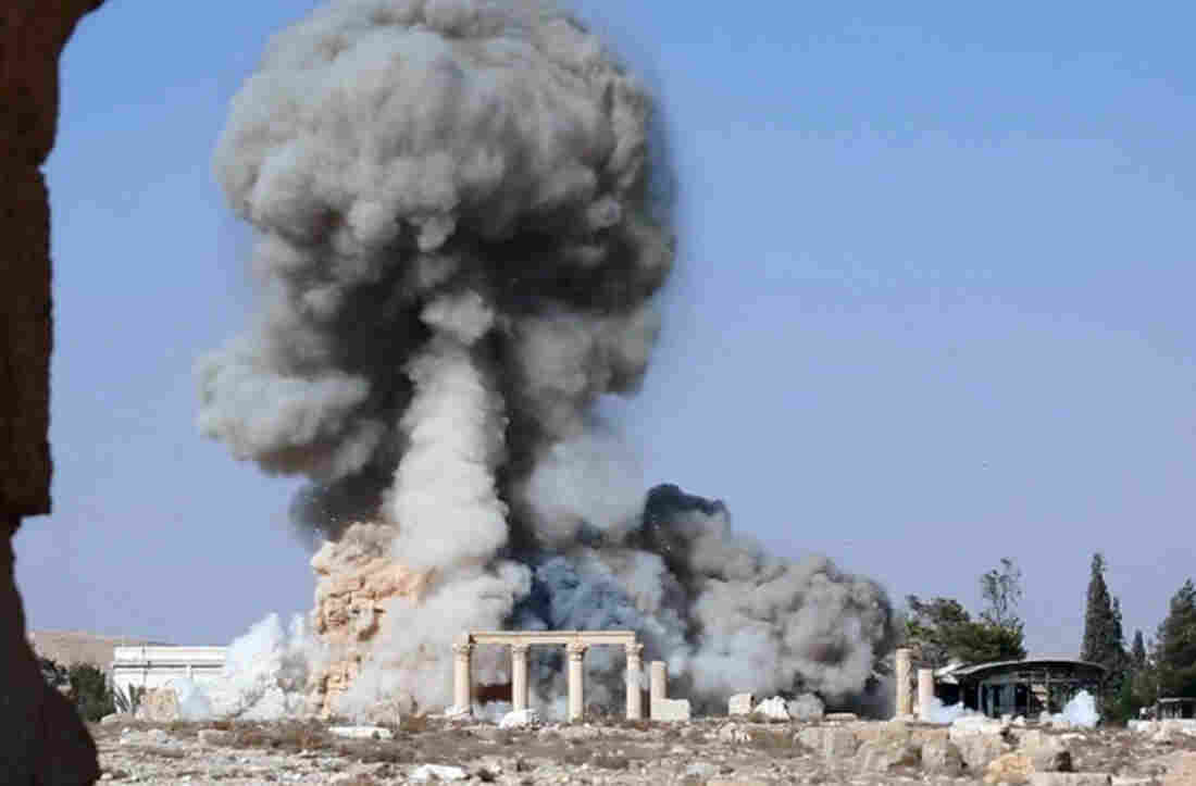 An undated image, released by the self-declared Islamic State, apparently shows the destruction of another famous site at Palmyra: the 2,000-year-old temple of Baalshamin. The image is consistent with reports that the militant group detonated explosives around the temple about a week before destroying the Temple of Bal.