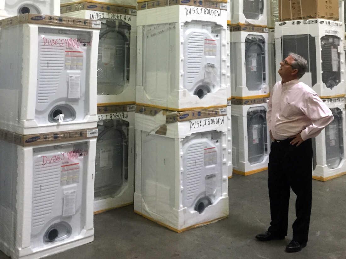 Roddey Player, CEO of Queen City Appliances surveys his stock.