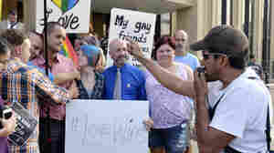 Edgar Orea, right, preaches to a group of same sex marriage supporters that gathered outside the Carl D. Perkins Federal Building in Ashland, Ky., on Thursday. Supporters of jailed County Clerk Kim Davis plan a prayer rally to call for her release.