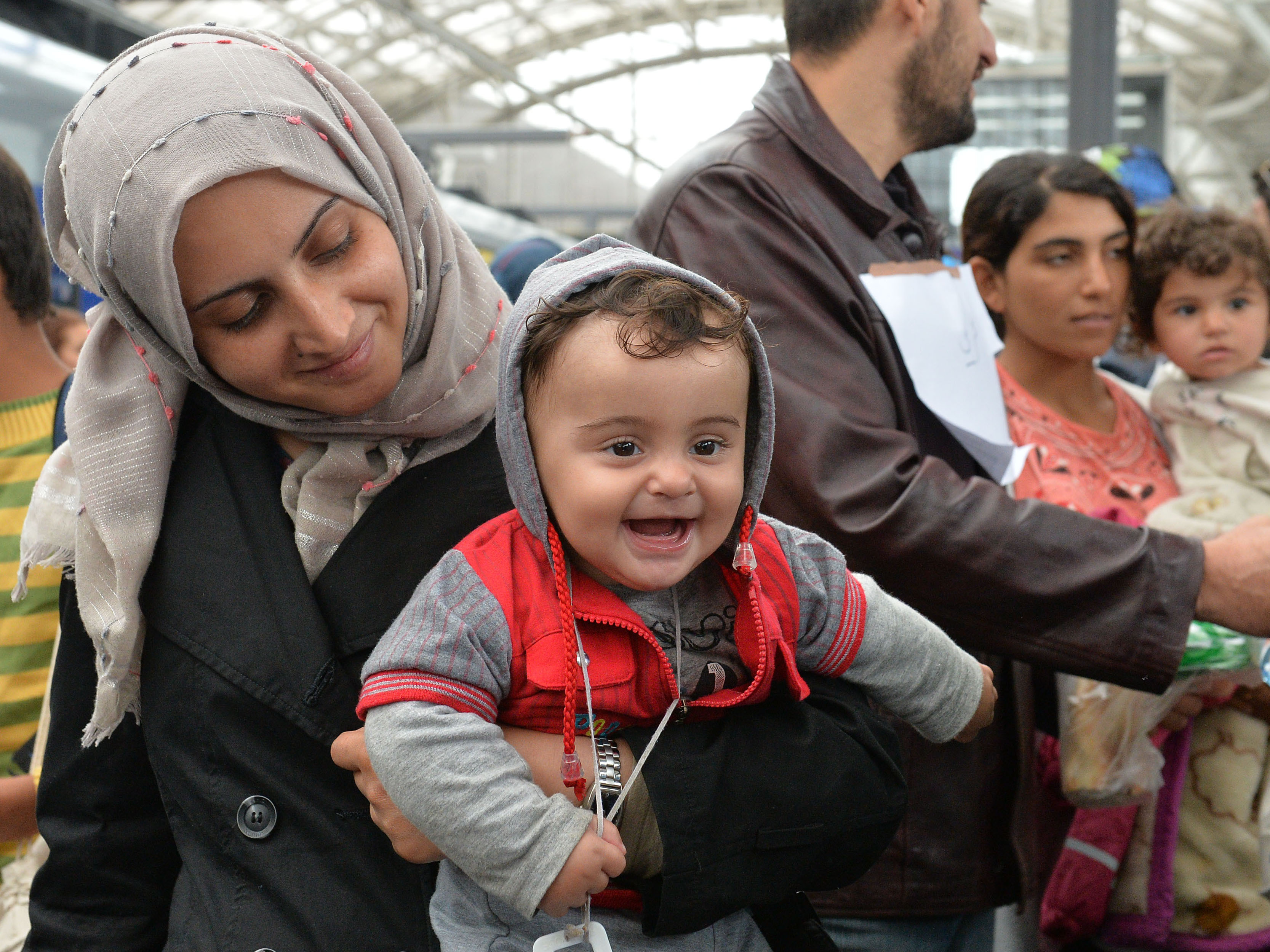 Migrants Arrive In Austria, Germany After Being Bused To Border