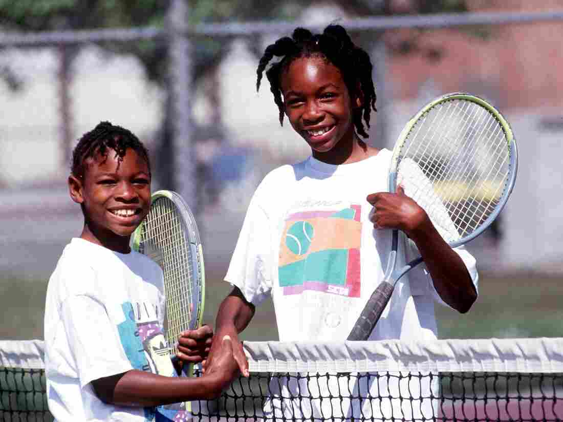 Sisters Serena, left, and Venus Williams shake hands after a match in 1991 in Compton, Calif.