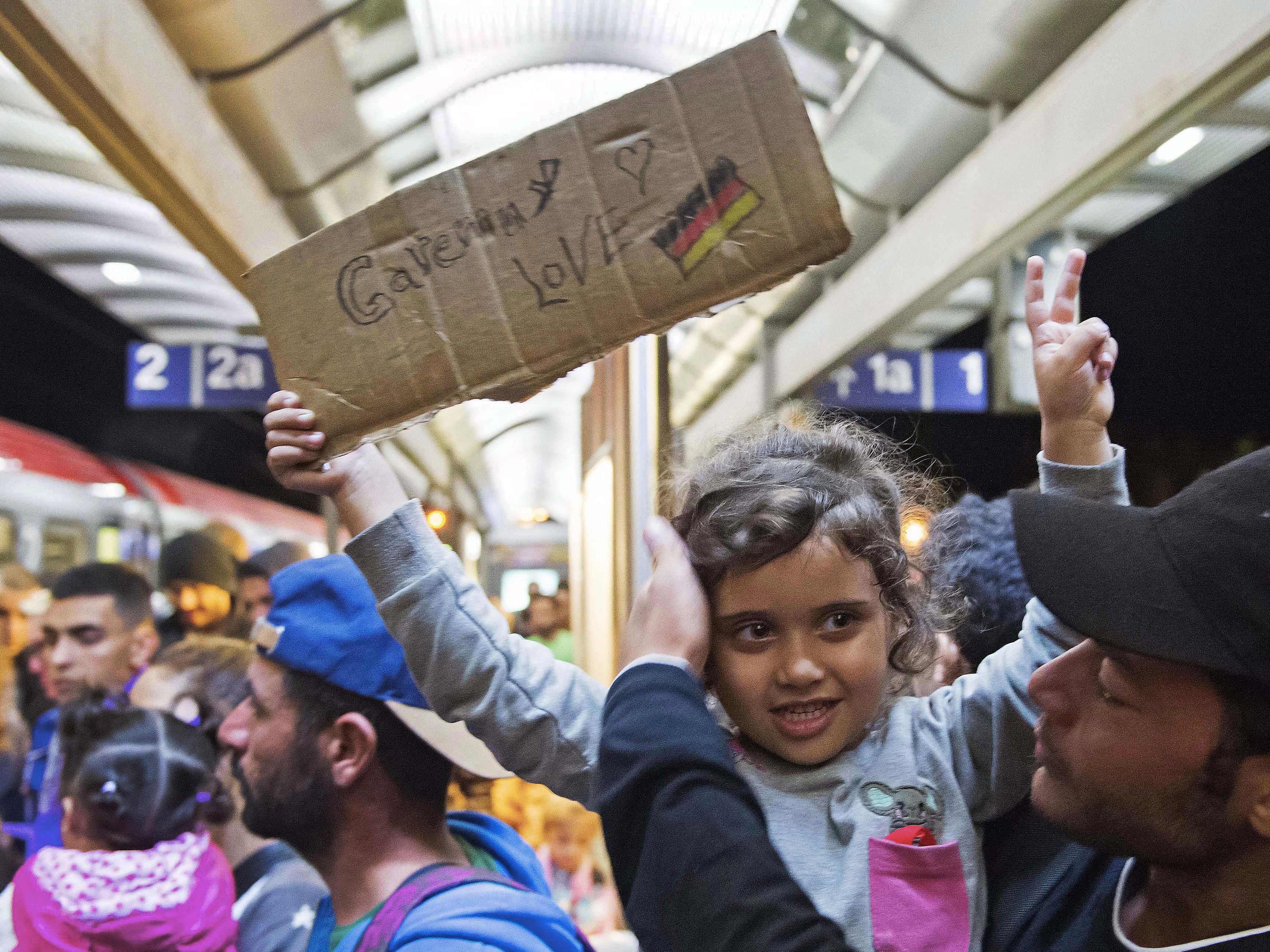 Trainloads Of Migrants Begin Arriving In Germany