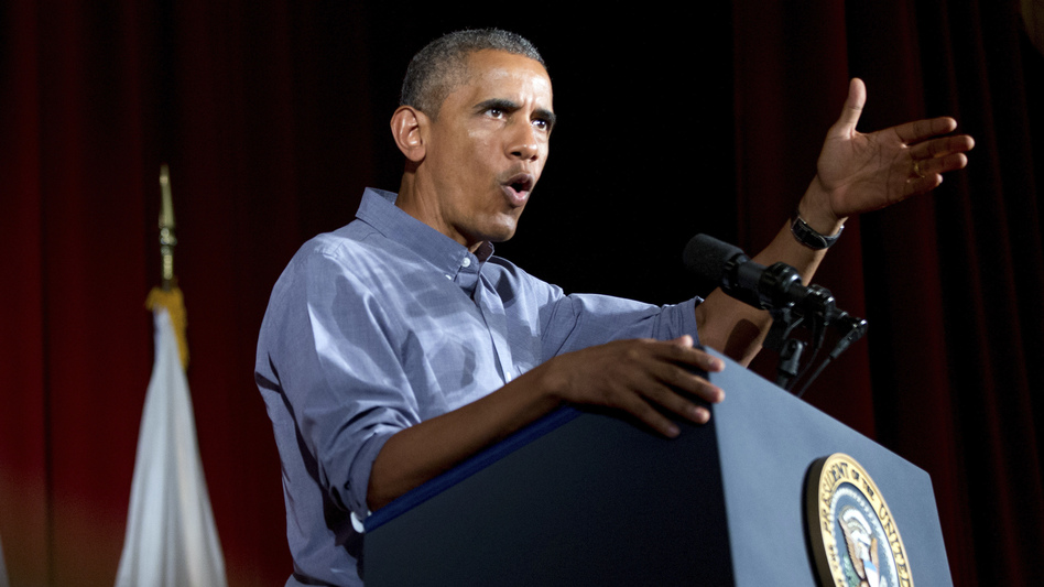 President Obama has signed an executive order that requires federal contractors to offer their employees up to seven days of paid sick leave per year. (Andrew Harnik/AP)