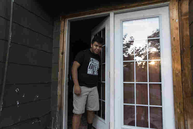 Jose pulls the door closed as the last one out of his Tulsa, Okla., home. Jose and his family leave the house around 7:30 a.m. each weekday in order to get everyone to school on time.