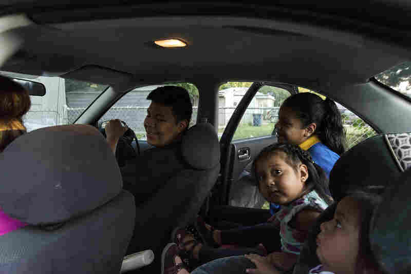 Jose Arriaga gets settled into the passenger seat of his mother's car. Veronica will make three stops, dropping off Jose first, then his sisters.