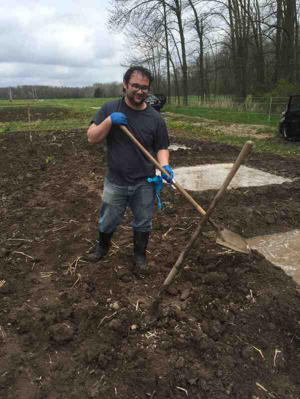 Naoki Shimoyama helps Michael Schläppi dig rice paddies 30 miles north of the Marquette lab in May.