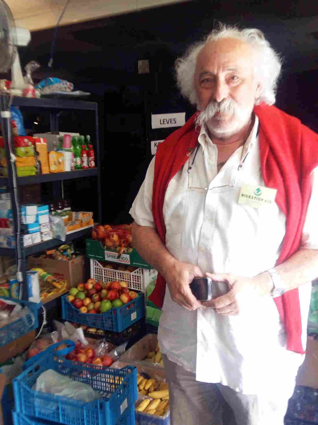 Robert Bekesi, a Hungarian Jew and Holocaust survivor, stands near some of the supplies he's transporting to an overcrowded migrant reception center near Hungary's border with Serbia. One of thousands of Hungarian volunteers, Bekesi has spent the past week making deliveries.