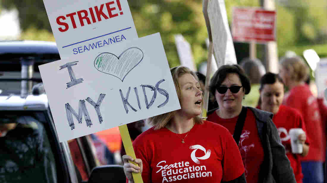 Teachers at West Seattle Elementary School begin walking a picket line Wednesday morning, after last-minute negotiations over wages and other issues failed to avert a strike.