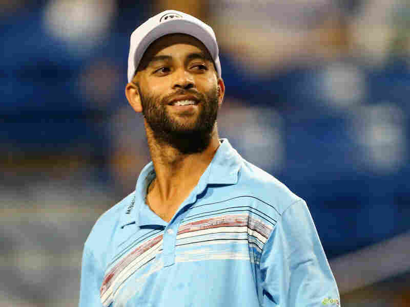 """In this Aug. 27 photo, retired tennis player James Blake looks on during a """"legends"""" match against Andy Roddick."""