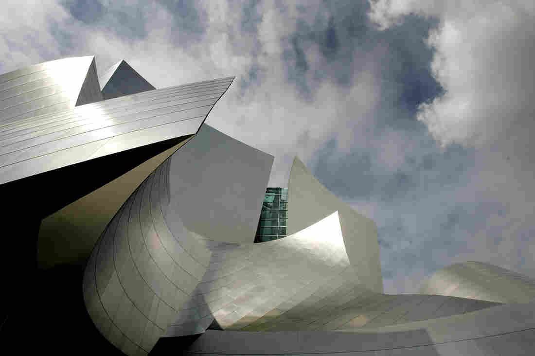 Light reflects off the shimmering stainless steel panels on Gehry's Walt Disney Concert Hall in Los Angeles.
