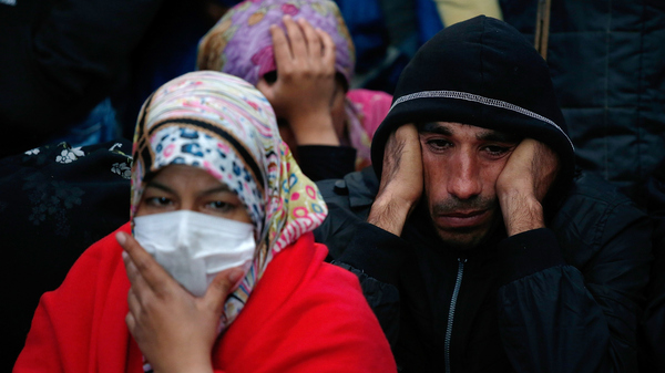 Syrian migrants at a train station in Keleti, Hungary, wait for a train bound for Munich, Germany, on Wednesday. As more migrants reach Germany, it is encouraging more in the Middle East to make the journey, according to some aid workers.