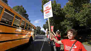 Teacher Jennifer Hall pickets with about 50 colleagues outside West Seattle High School last week.