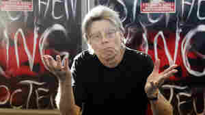 Stephen King poses for the cameras during his promotional tour for the novel Doctor Sleep in 2013. Now, just imagine him in a suit and tie, with a medal around his neck.