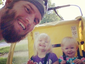 Bryan Odeen and his daughters, before hitting the road for their morning run.