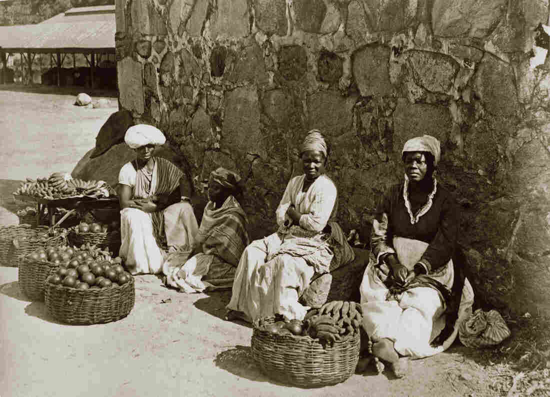 "A photo from 1875 in Rio de Janeiro shows women street sellers called ""quitandeiras,"" also known as ""slaves who earn."" A portion of the profits was returned to their masters."