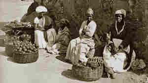 """A photo from 1875 in Rio de Janeiro shows women street sellers called """"quitandeiras,"""" also known as """"slaves who earn."""" A portion of the profits was returned to their masters."""