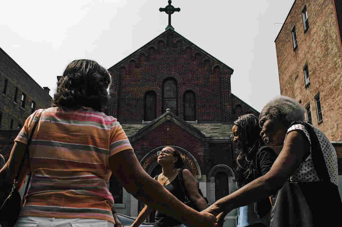 The church of Our Lady Queen of Angels in New York City's East Harlem neighborhood closed in 2007, but parishioners still congregate outside the parish for service every Sunday.