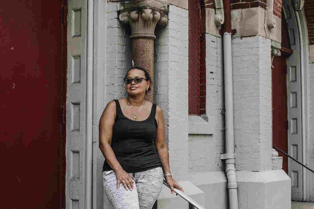 Patricia Rodriguez, a former parishioner and organizer of the informal Mass outside Our Lady Queen of Angels, stands in front of the church. She was once led out of the church in handcuffs by the police after protesting its closing.