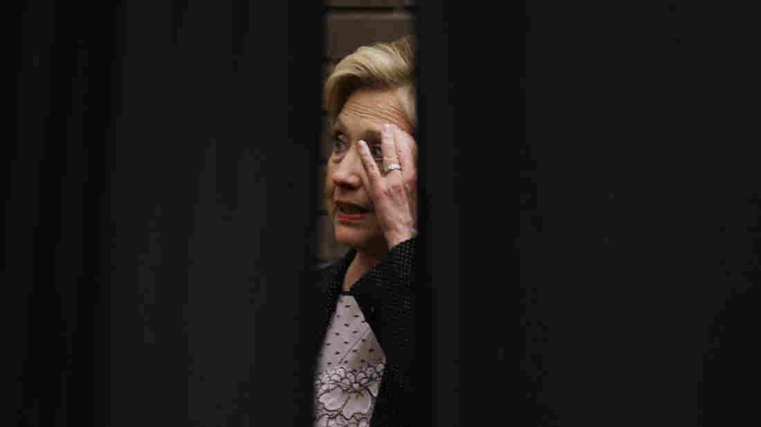 Hillary Clinton waits behind a curtain before a rally at the University of Wisconsin, Milwaukee on Thursday. She continues to struggle to explain her use of a private email server while secretary of state.