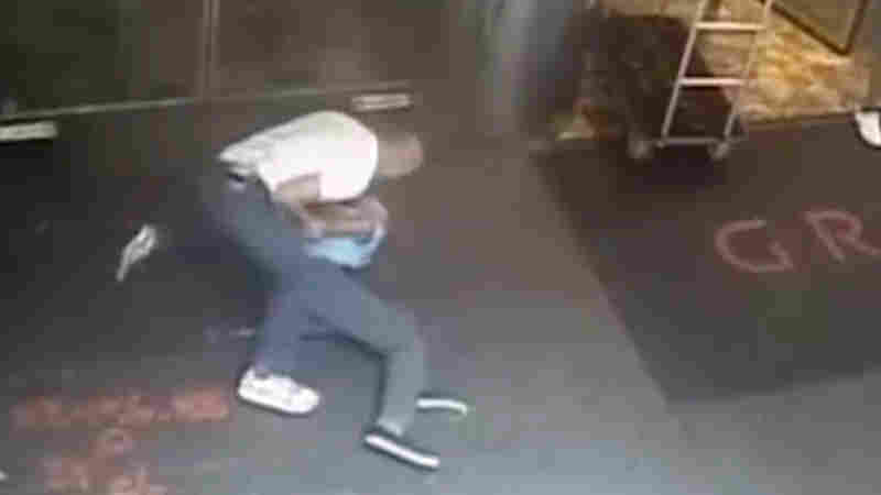 This image taken from a surveillance camera and released by the New York Police Department shows former tennis star James Blake (right) being arrested by plainclothes officer James Frascatore outside the Grand Hyatt New York hotel on Wednesday.