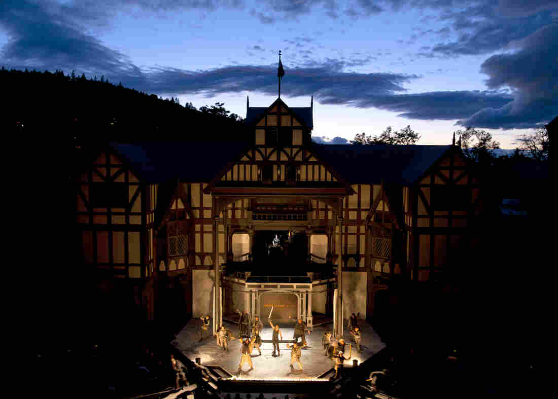 The Oregon Shakespeare Festival's Elizabethan Theatre — shown above during a production of Henry V in 2012 — seats 1,200 people under the open sky. With wildfires raging in Washington state, the festival has installed air quality monitors for the safety of the audience, staff and performers.