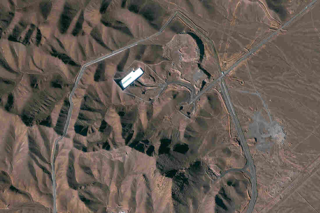 A satellite image shows the Fordow facility in Iran. Under an agreement with six world powers, Iran would stop enriching uranium at the facility.
