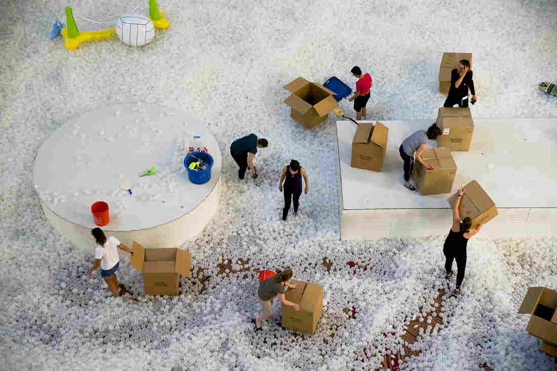 """It took volunteers 25 hours to move 750,000 plastic balls from the National Building Museum's """"Beach"""" installation to Dupont Underground, a creative arts institution in Washington, D.C."""