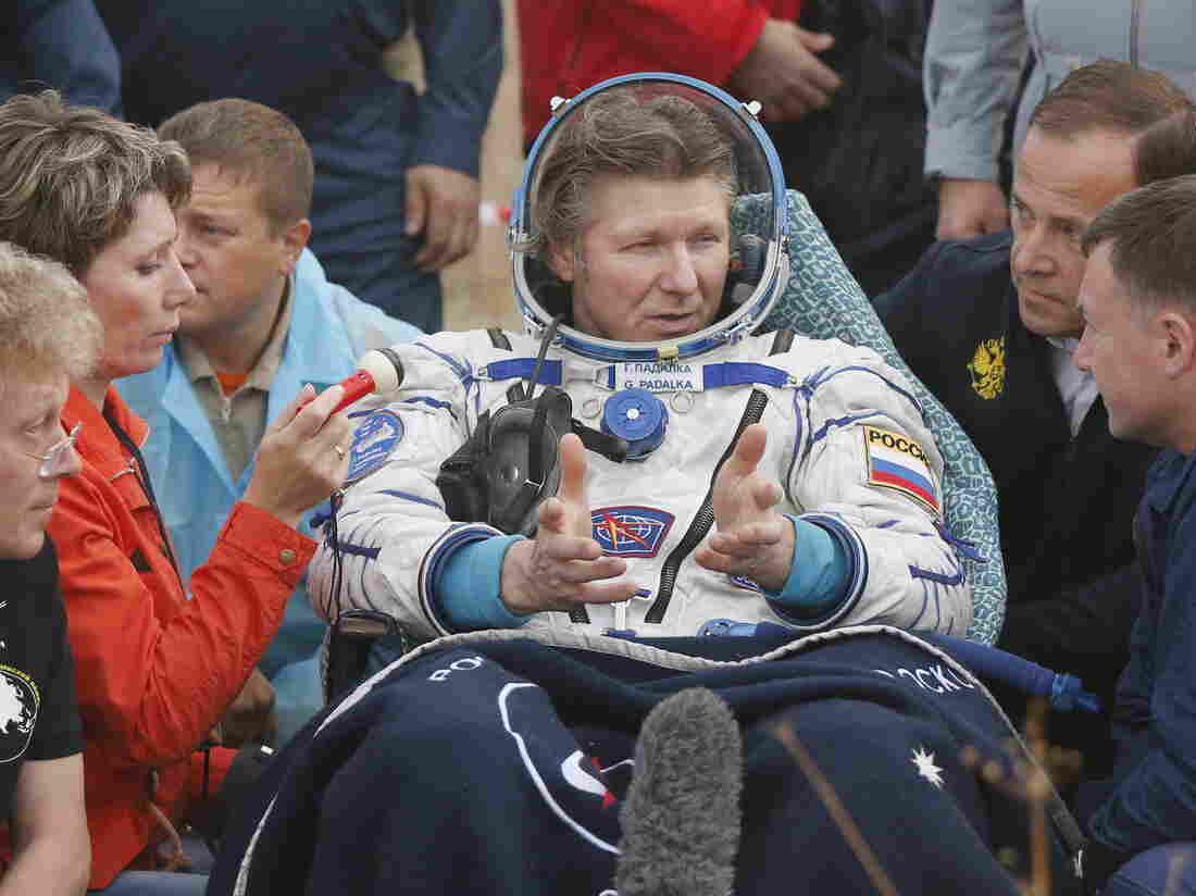 Russian cosmonaut Gennady Padalka gestures after landing near the town of Dzhezkazgan (Zhezkazgan), Kazakhstan, on Saturday.
