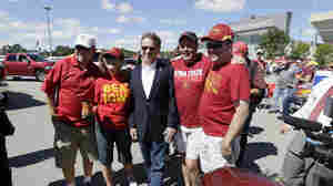 Sen. Rand Paul, R-Ky., poses for a photo with Iowa State University football fans before their game against the University of Iowa on Saturday.
