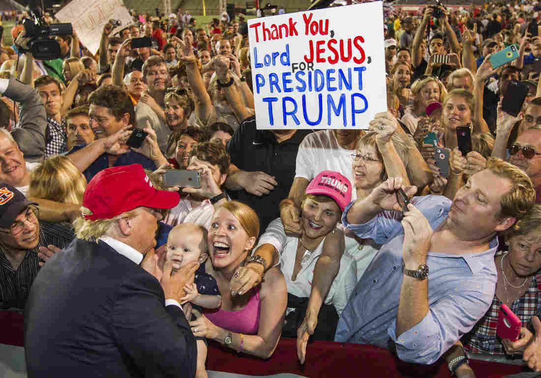 Enthusiastic supporters greet Donald Trump at a rally of more than 30,000 in Mobile, Ala., in August.