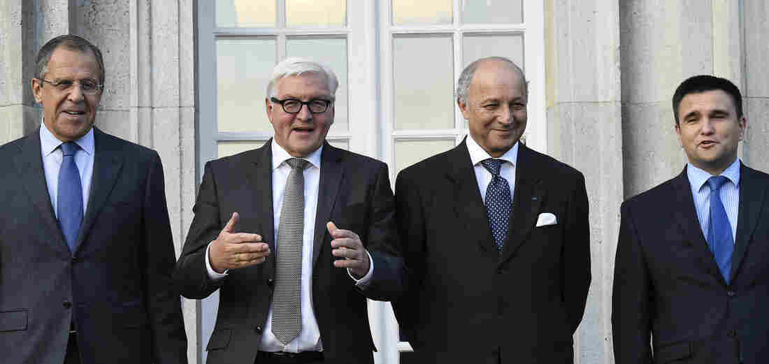 Russian Foreign Minister Sergey Lavrov, German Foreign Minister Frank-Walter Steinmeier, French Foreign Minister Laurent Fabius and Ukrainian Foreign Minister Pavlo Klimkin pose for a picture ahead of their meeting at the foreign ministry's guesthouse, Villa Borsig, at Lake Tegel in Berlin on Saturday.