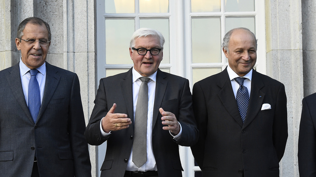Russian Foreign Minister Sergey Lavrov, German Foreign Minister Frank-Walter Steinmeier, French Foreign Minister Laurent Fabius and Ukrainian Foreign Minister Pavlo Klimkin pose for a picture ahead of their meeting at the foreign ministry's guesthouse, Villa Borsig, at Lake Tegel in Berlin on Saturday. (AP)