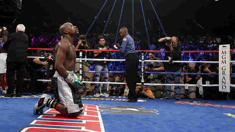 Floyd Mayweather Jr. kneels at the end of his welterweight title boxing bout against Andre Berto on Saturday, in Las Vegas. Mayweather says it's his last fight. If so, he retires with an undefeated record of 49-0.