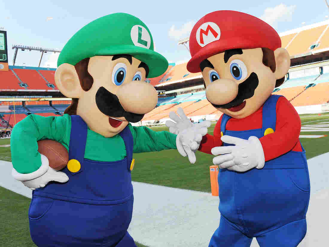 Mario (right) and his brother Luigi, pictured before a college football game in 2014 in Florida, are the iconic characters from Super Mario Bros. video game franchise.