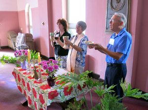 Caryl Johnson (center) oversees communion at St. Mary Magdalene Community in Drexel Hill, Pa., as parishioners Janet Hamm and Jim Kalb assist. Unlike most traditional Roman Catholic services, a gluten-free bread and alcohol-free wine are offered.