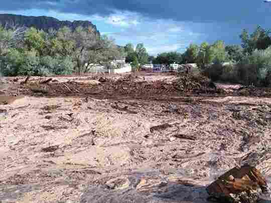 Debris and water cover the ground in Hildale, Utah, where a flood ripped through the town Monday.