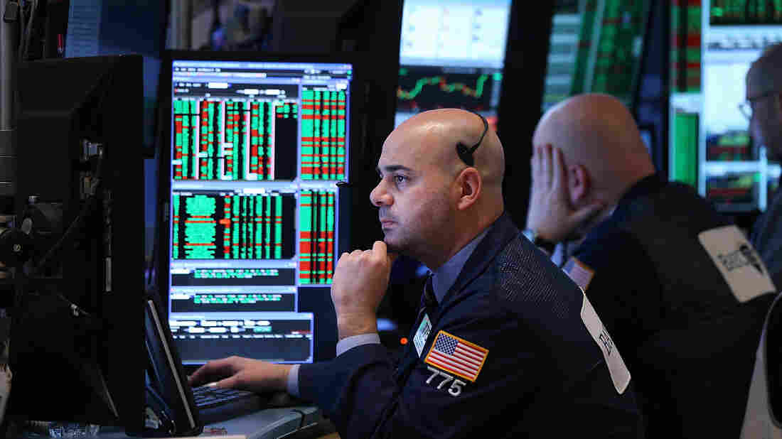 Traders work on the floor of the New York Stock Exchange in March. Investors have been waiting to see whether the Federal Reserve will raise interest rates for the first time since 2006.