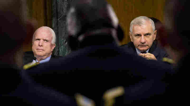 Sens. John McCain, R-Ariz., (left) and Jack Reed, D-R.I., hear testimony on operations against ISIS from Gen. Lloyd Austin.