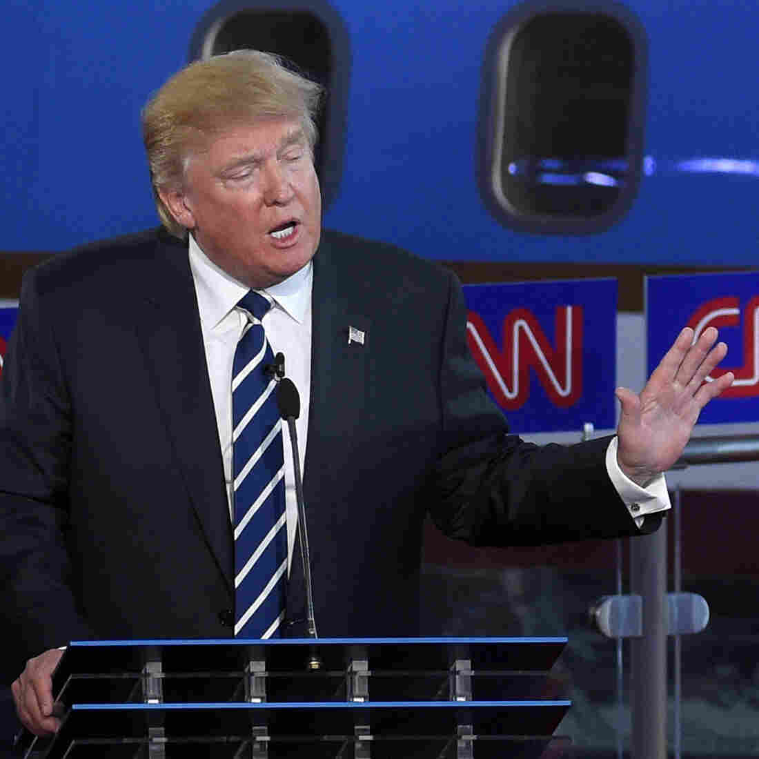 In the early going in the second GOP debate, Donald Trump (left) was targeted by Wisconsin Gov. Scott Walker (right), Florida Gov. Jeb Bush and others.