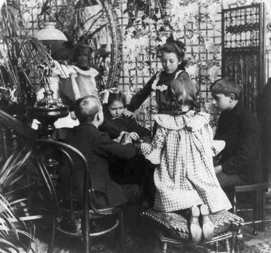 Children playing a game in 1906.