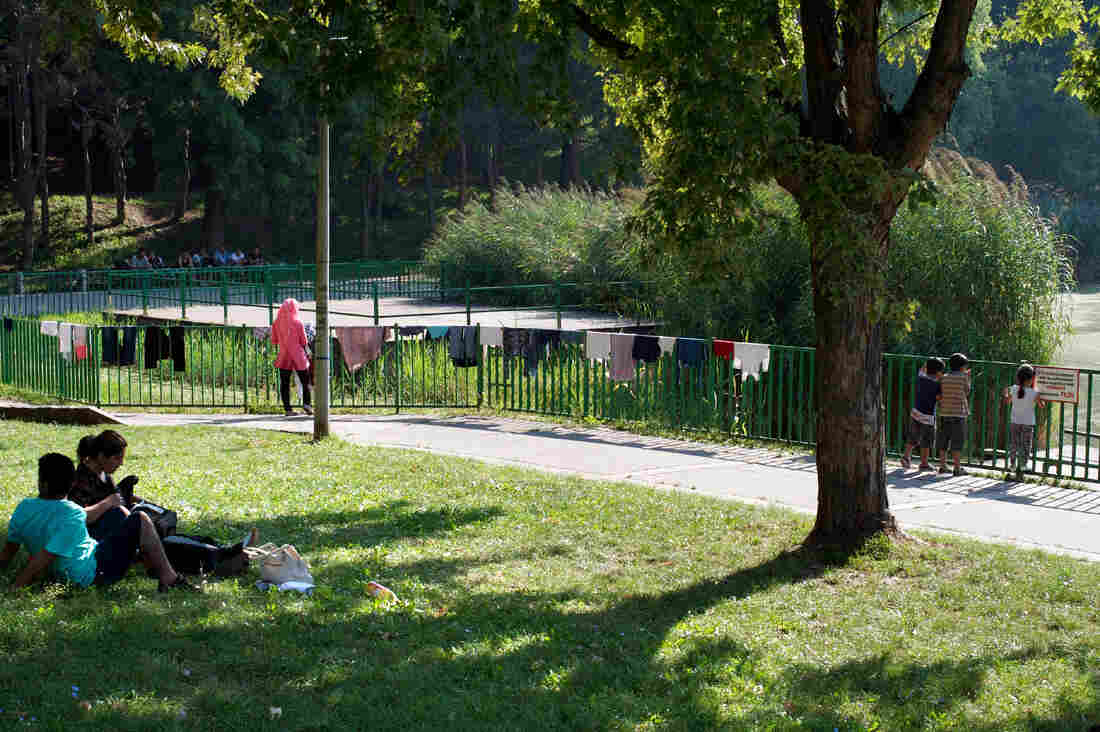 Clothes dry on the side of a fence at a city park in Budapest where Syrians camped out. Most hotels and hostels don't rent rooms to refugees and migrants.