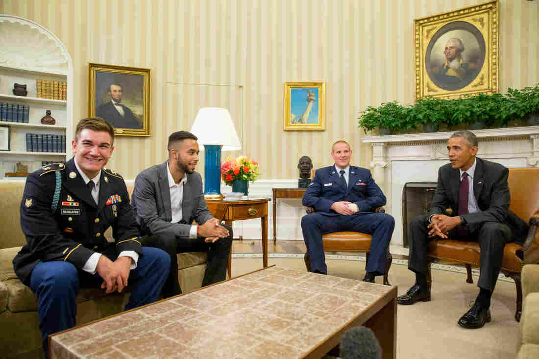 President Obama meets with (from left) Oregon National Guardsman Alek Skarlatos, Anthony Sadler and Air Force Airman 1st Class Spencer Stone on Thursday in the Oval Office of the White House.