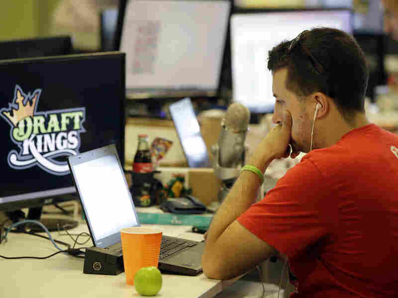 Devlin D'Zmura, a tending news manager at DraftKings, works on his laptop Sept. 9 at the company's offices in Boston.