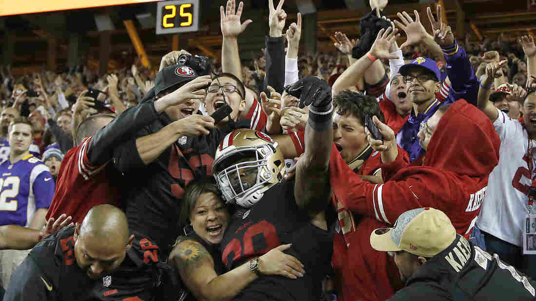 San Francisco 49ers fans celebrate a touchdown with running back Carlos Hyde on Monday in Santa Clara, Calif.