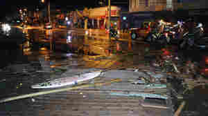 Police patrol a debris-strewn street in Valparaiso, Chile, following an 8.3 magnitude quake off the coast.
