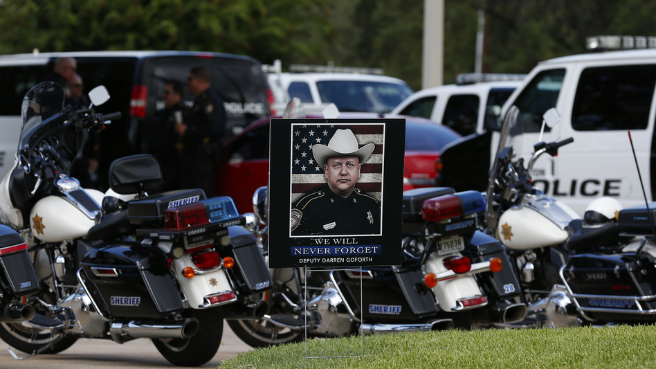 """The funeral for Harris County Sheriff Deputy Darren Goforth was held Sept. 4 in Houston. After Goforth was fatally shot at a gas station on Aug. 29, some spoke about a """"war on cops."""" But while 2014 did see more officer deaths than 2013, one expert says that's not a sign of a statistically significant spike. (Aaron M. Sprecher/Getty Images)"""