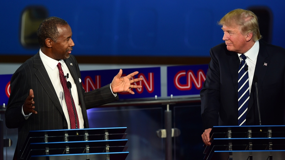 Republican presidential hopefuls, retired neurosurgeon Ben Carson and real-estate mogul Donald Trump talk about childhood vaccines during the second Republican presidential debate. (Frederic J. Brown/AFP/Getty Images)