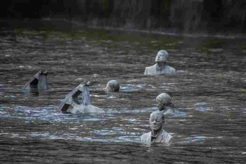 At high tide, the four sculptures of The Rising Tide are almost entirely submerged.
