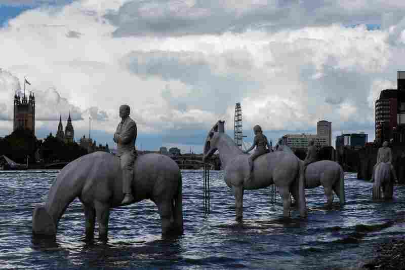 The Rising Tide, on the shore of Thames River in London. Each horse is a hybrid — half animal, half oil pump.
