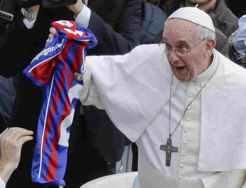 Pope Francis holds a San Lorenzo jersey handed to him at the end of the Easter Mass at the Vatican on March 31, 2013. The pope is an avid fan of the Buenos Aires soccer team.